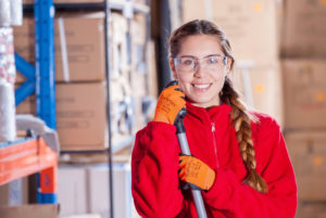 Canva - Female Worker Wearing Protective Goggles in the Warehouse (1)