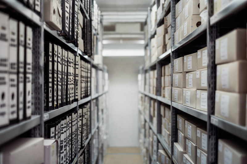 Canva - Archives and Boxes in Warehouse