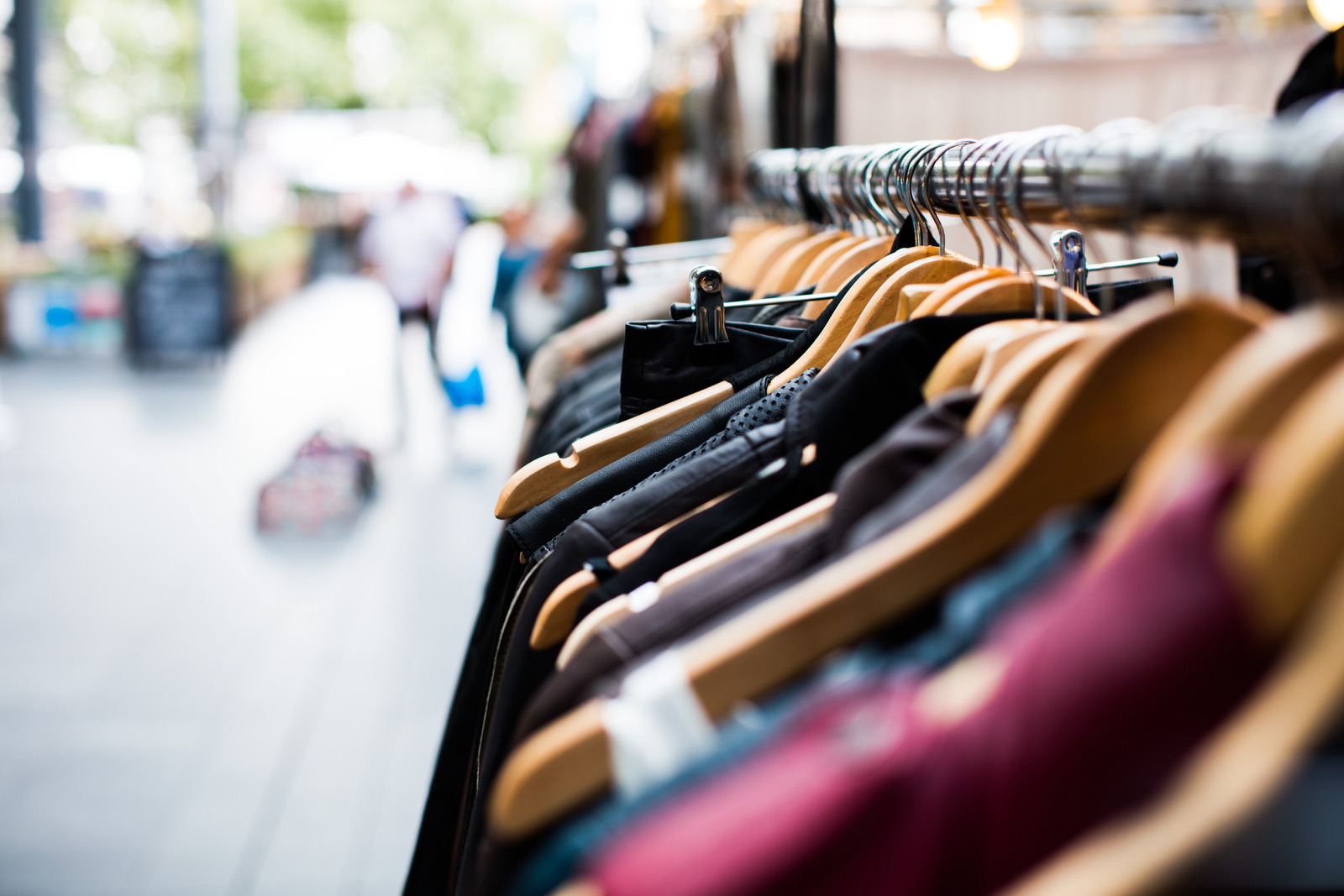 Canva - Clothes in Hanger Rack in Open Market