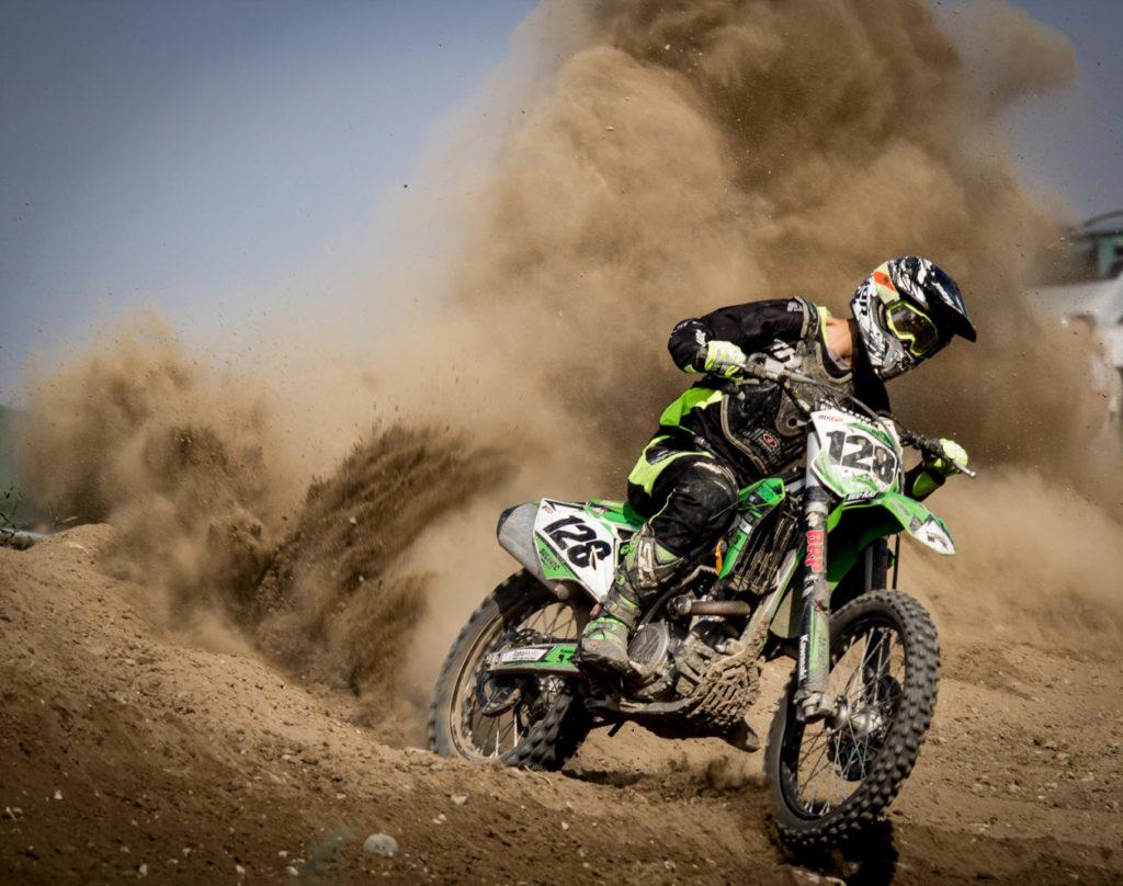 Canva - Rider Riding Green Motocross Dirt Bike