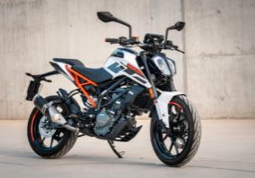 Canva - Photo of a black, white and orange motorcycle